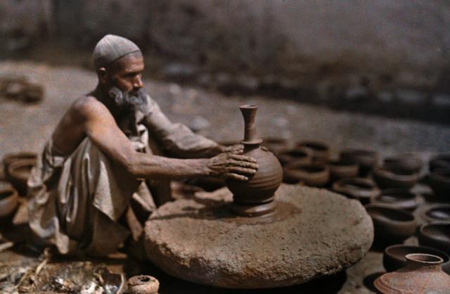 A man works at his potter's wheel Srinagar 1929